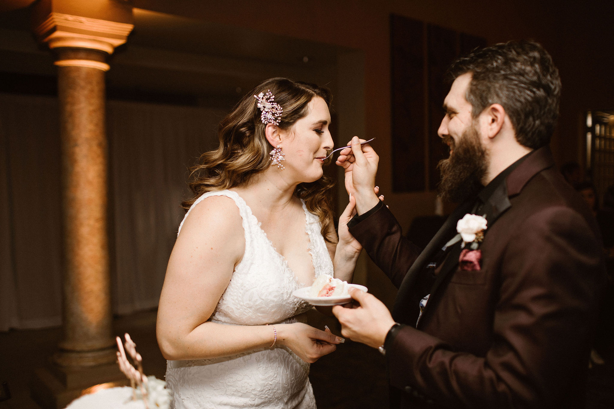 groom feeding cake to bride