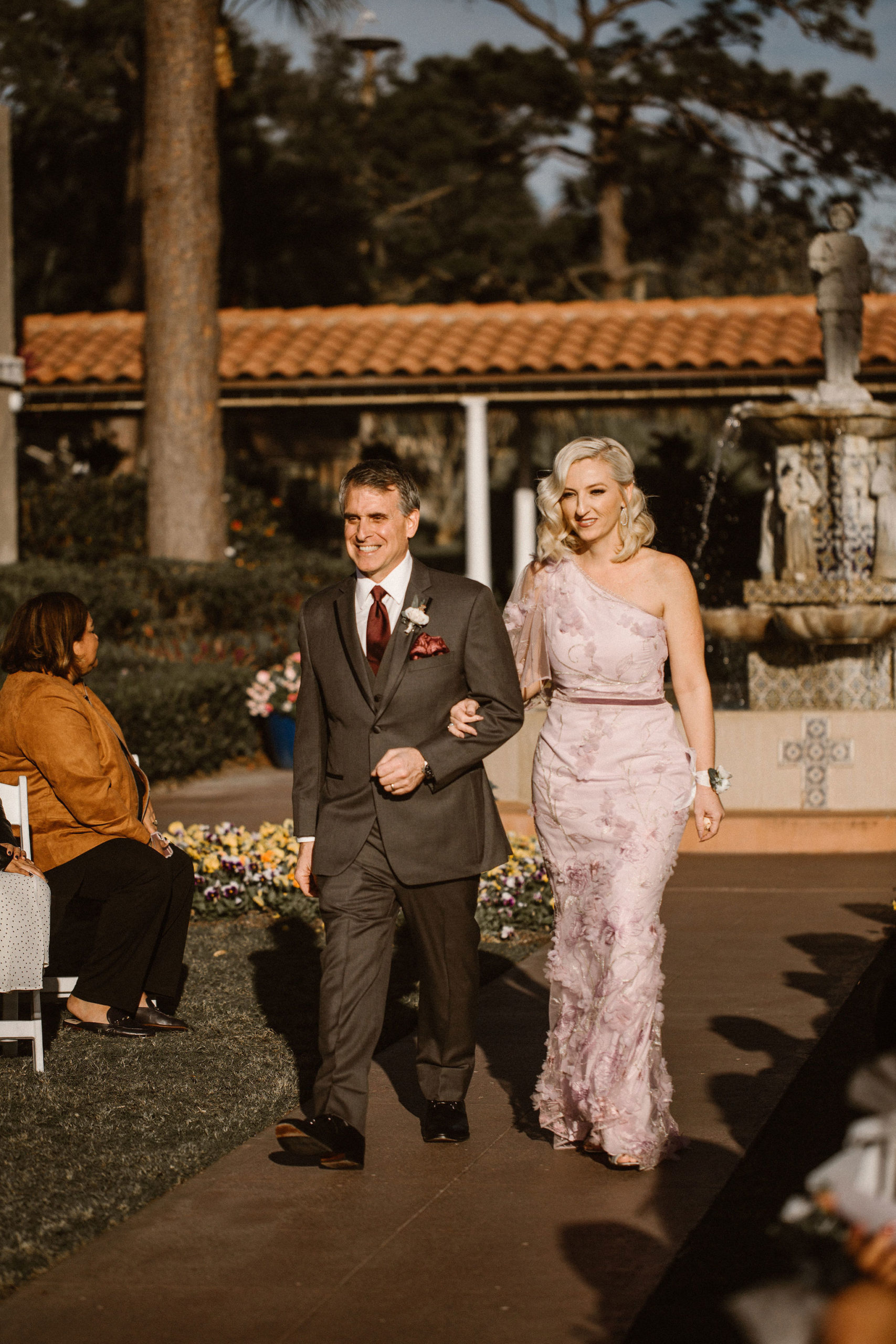 Wedding Party Walking Down the Aisle at Mission Inn Resorts Plaza de la Fontana for a romantic, mauve wedding