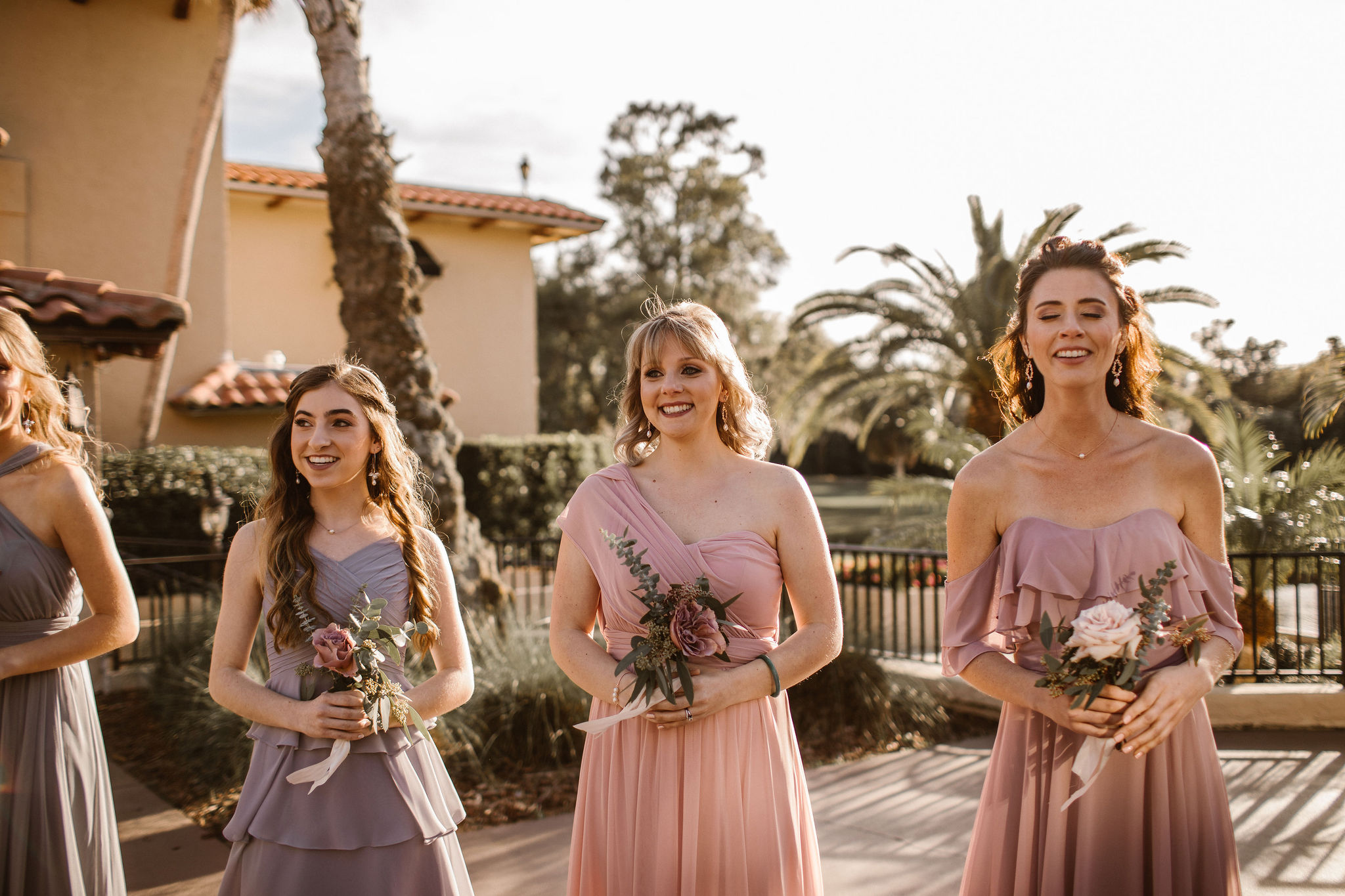 Bridesmaids in mauve dresses awaiting bride