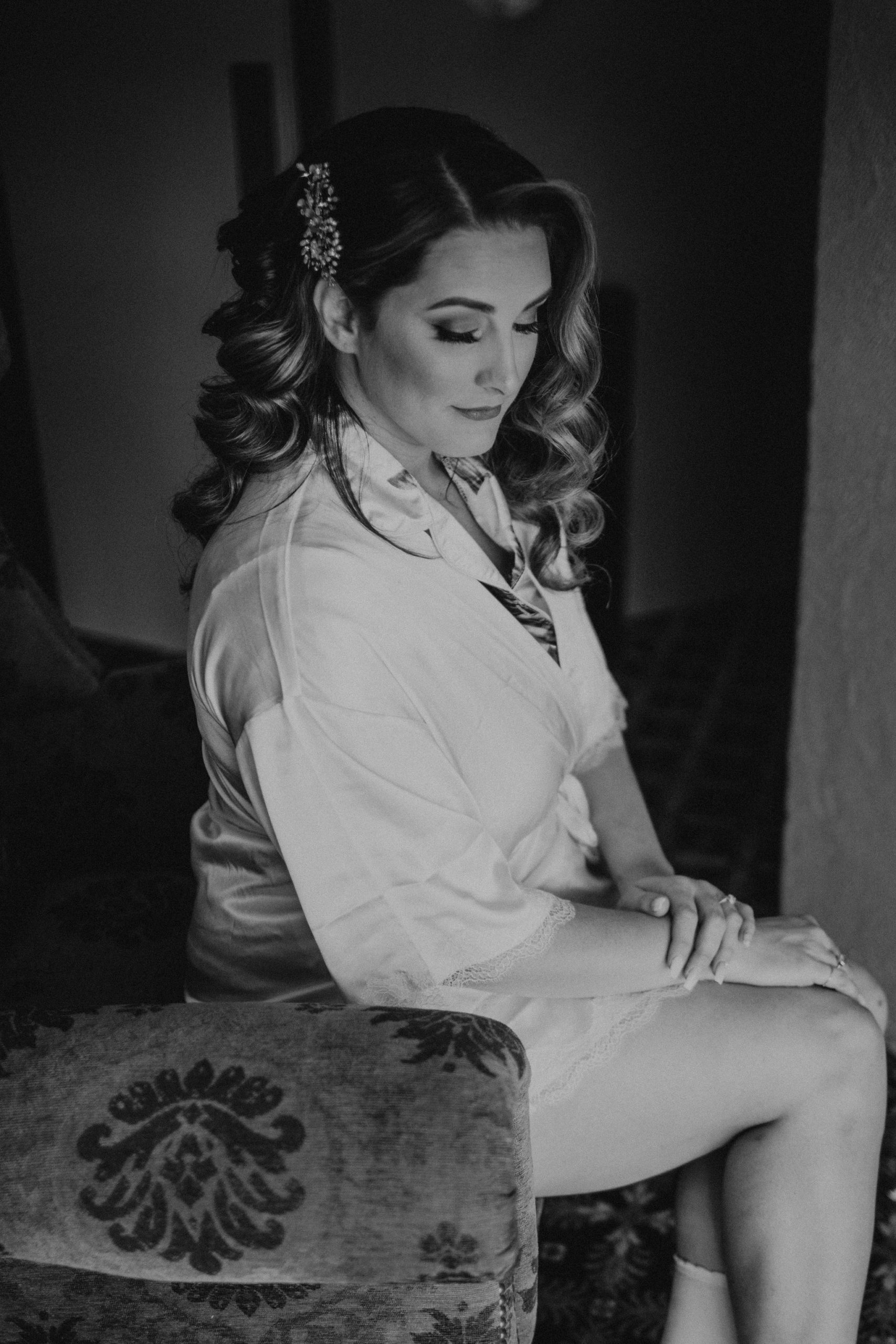 black and white photo of bride sitting in chair