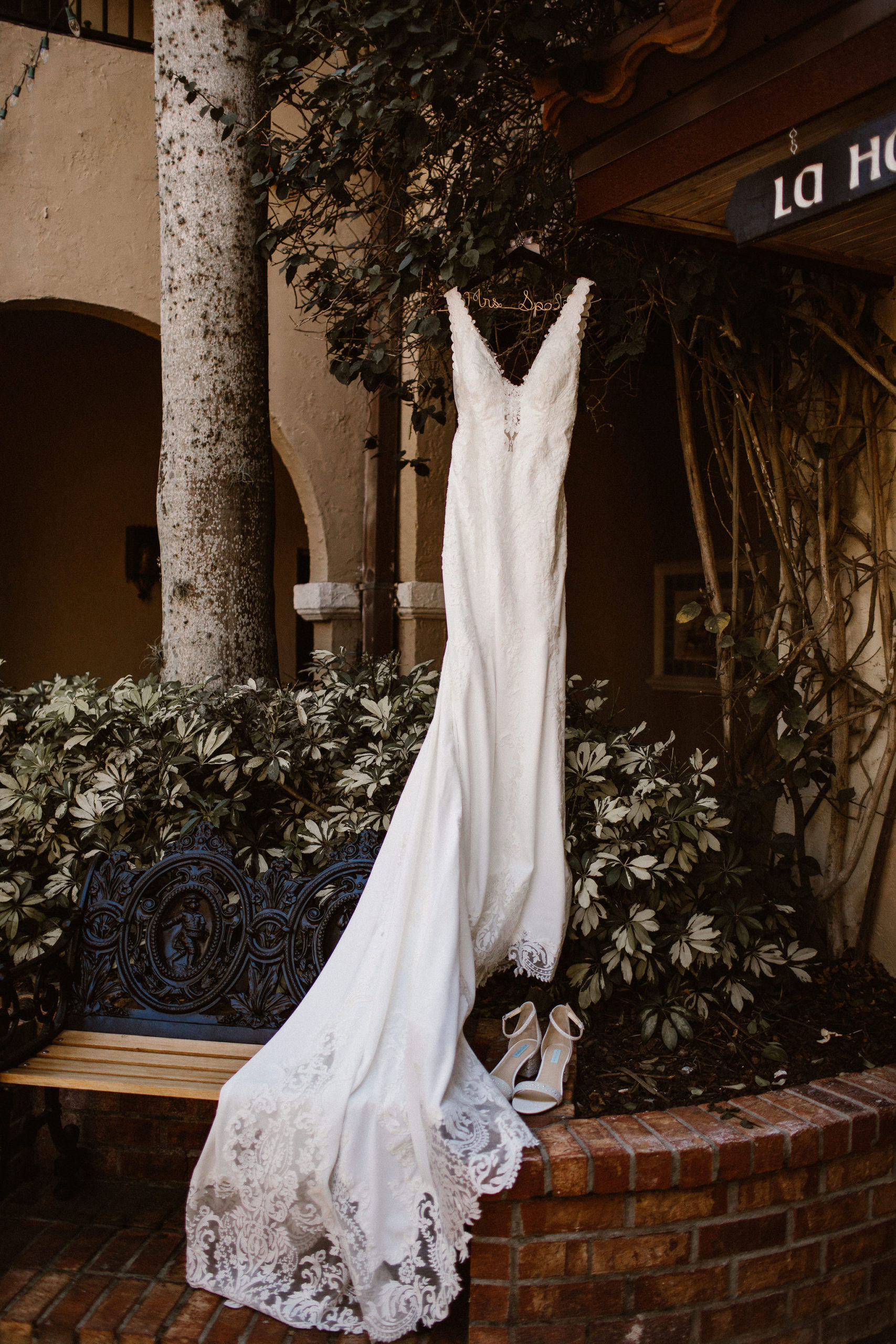 bride's dress hanging in Mission Inn's Plaza de las Palmas