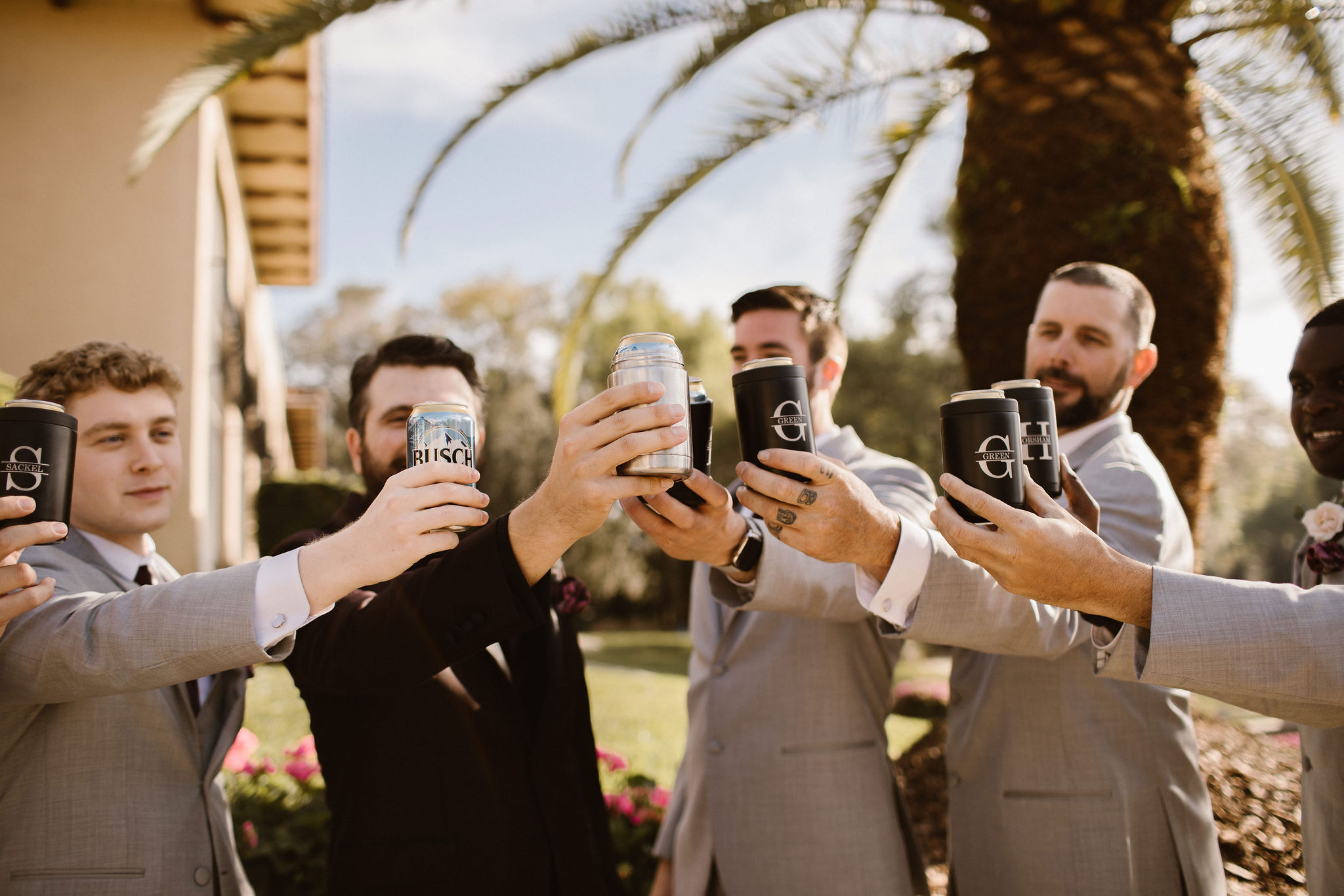 groomsmen with beer coozies on wedding day