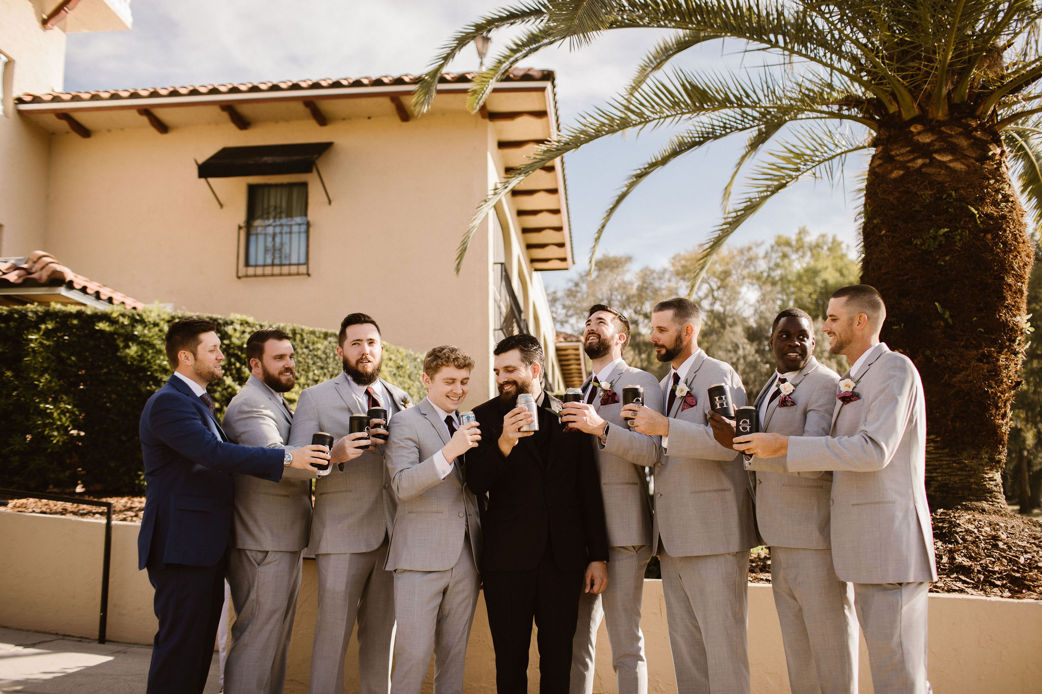 groom and groomsmen getting ready for wedding day