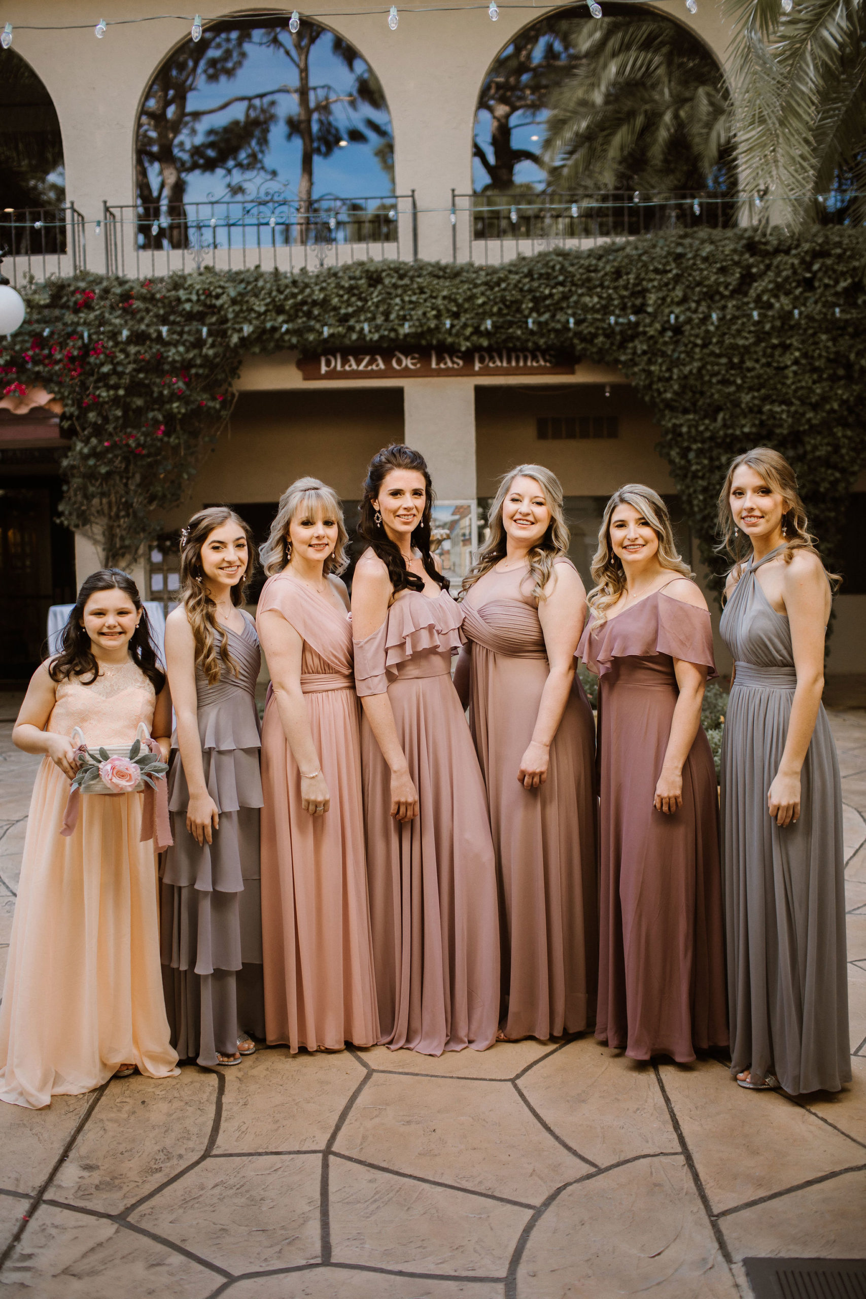 bridesmaids in different shades of mauve and grey