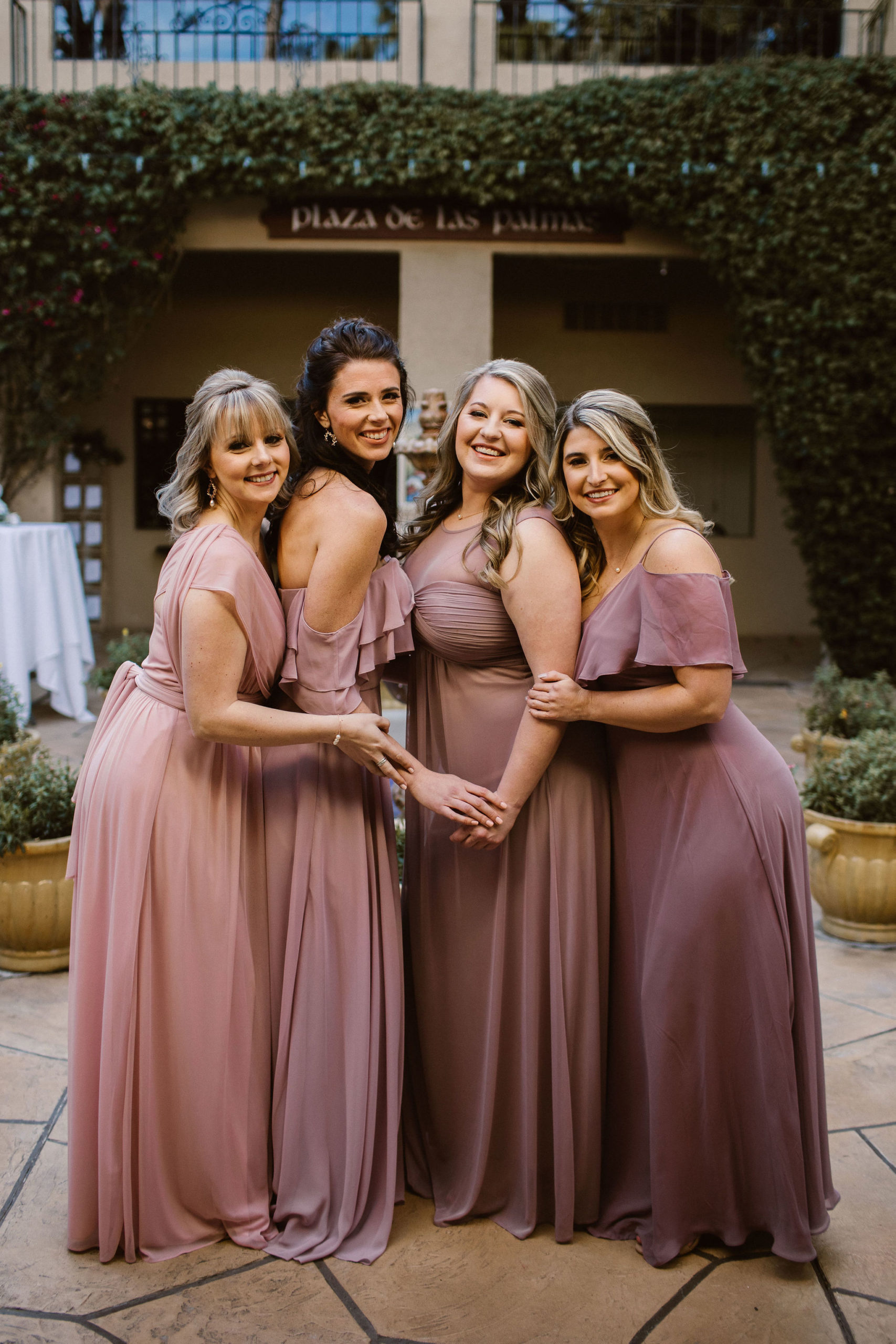 bridesmaids in different shades of mauve for romantic wedding