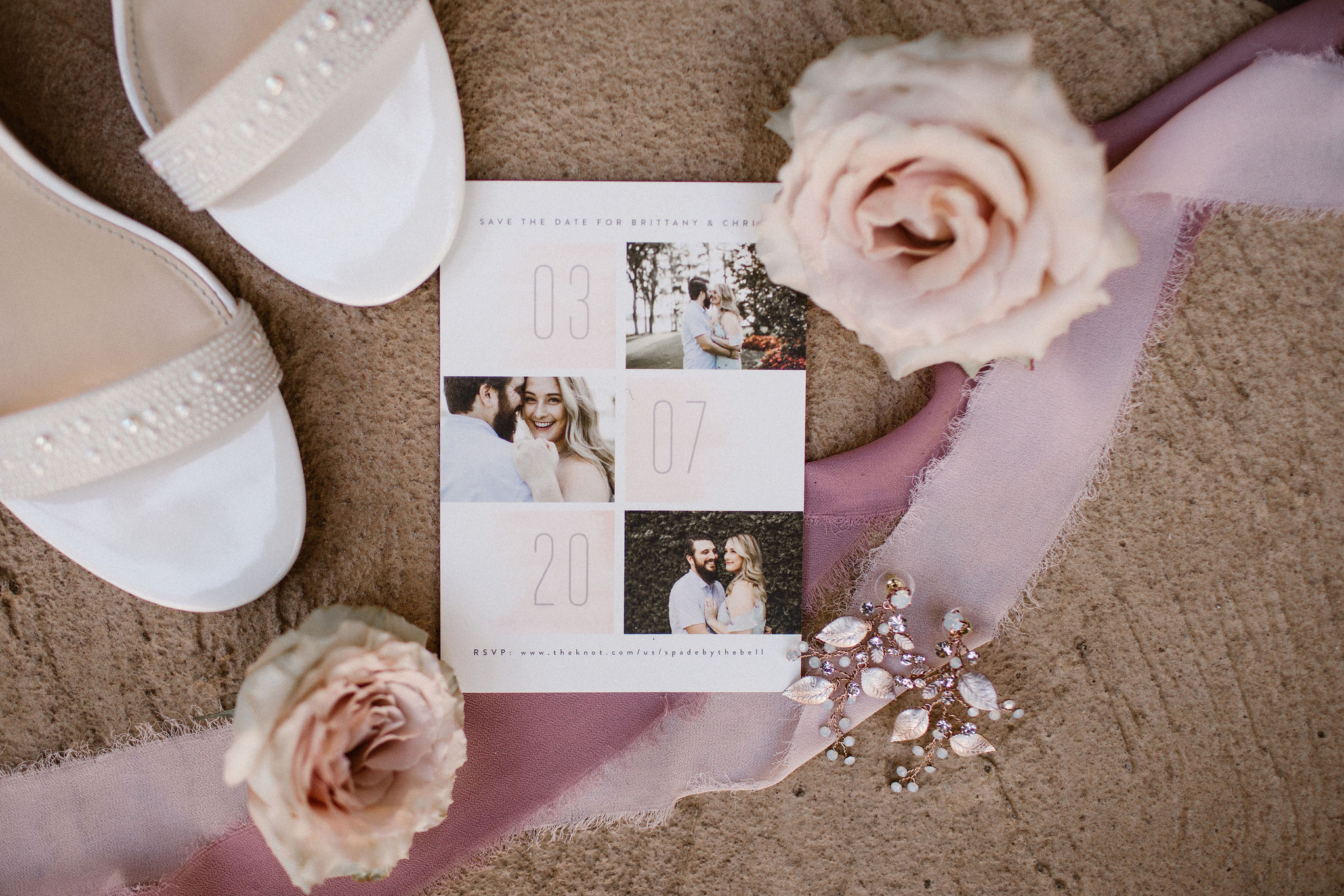 couples detail shot with invitation shoes and hair piece for romantic wedding day with mauve ribbons in background
