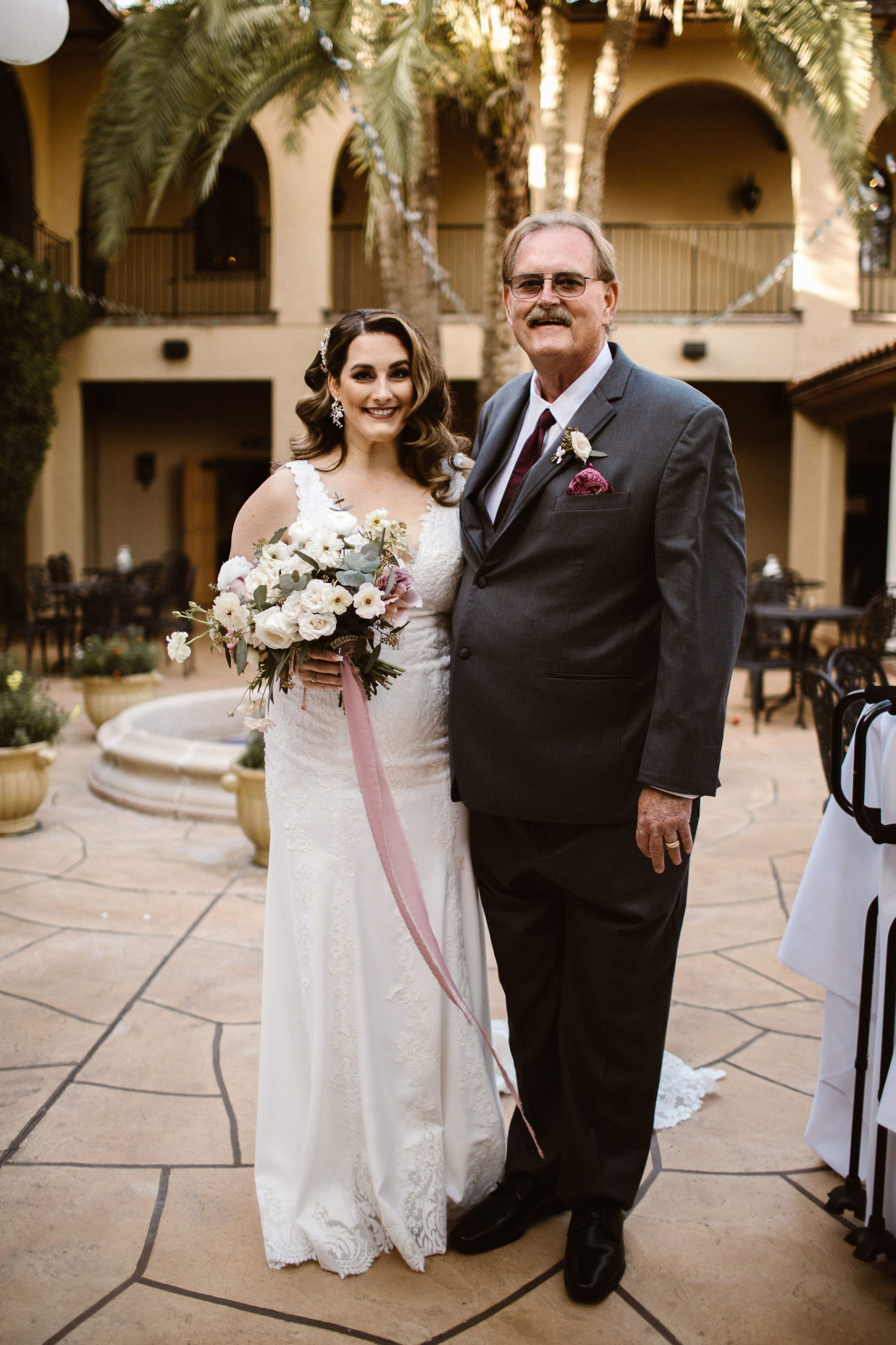 bride and her dad on wedding day