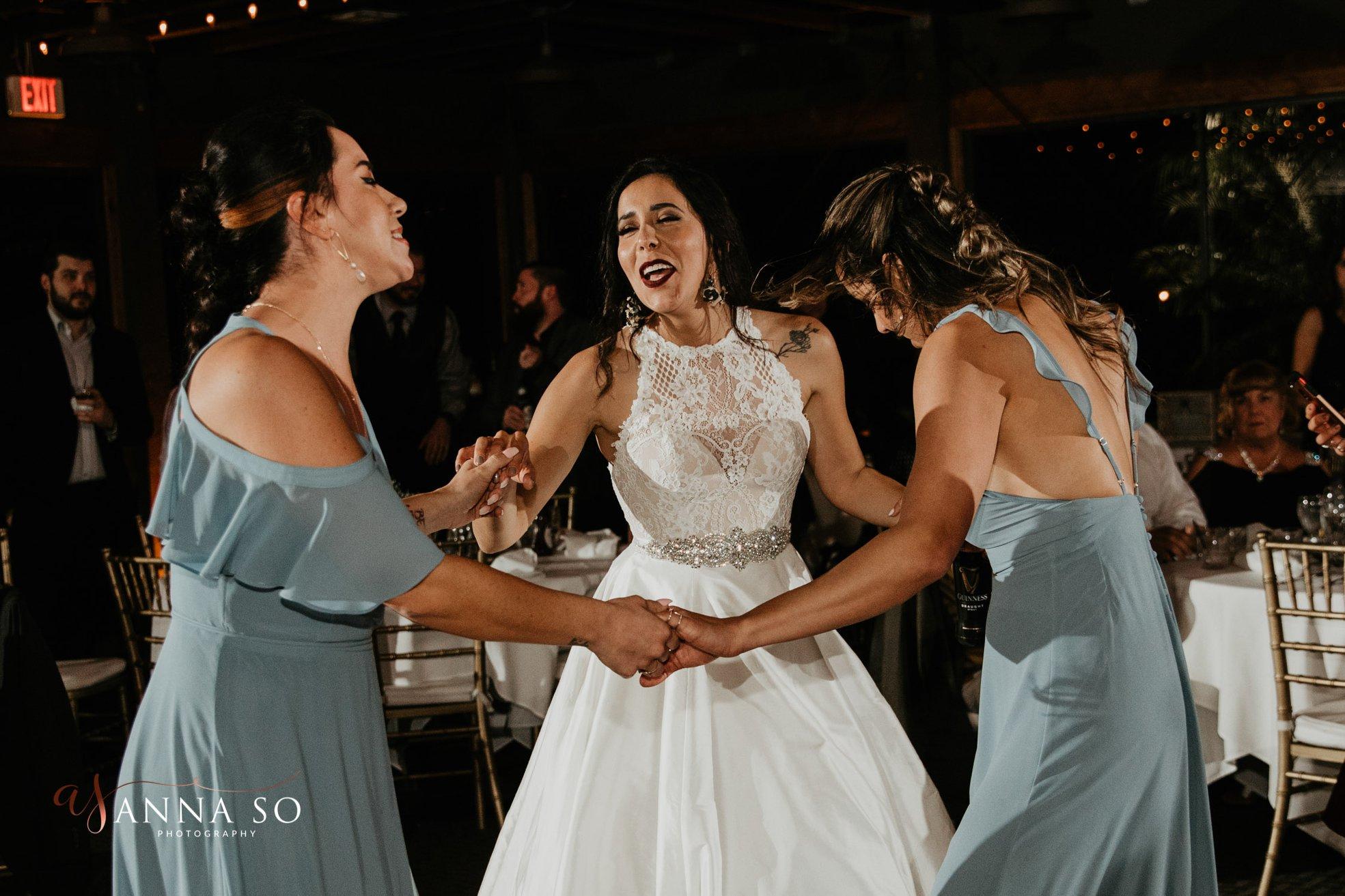 Gina dances with her Bridesmaids